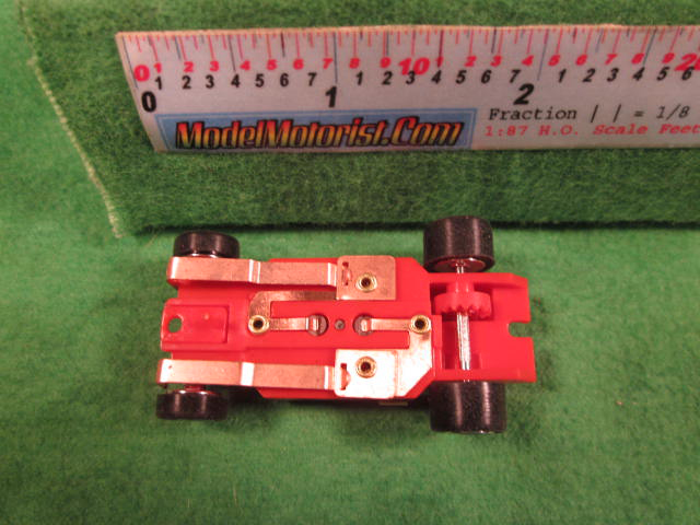 Bottom view of Dash IROC Red (Correct) HO Slot Car Chassis