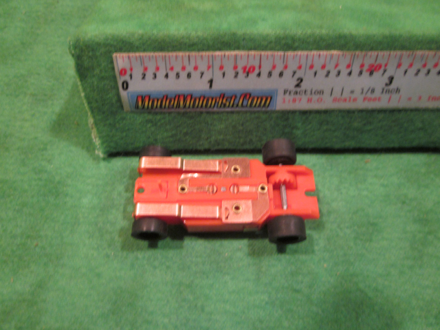 Bottom view of Dash T 2.0 IROC Orange HO Slot Car Chassis