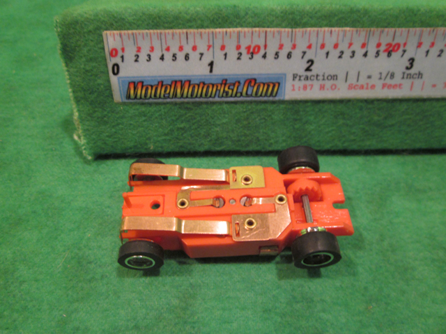 Bottom view of Dash IROC Red (Error) HO Slot Car Chassis