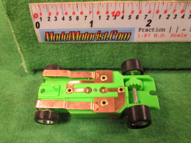 Bottom view of Dash T 2.0 Neon Green HO Slot Car Chassis
