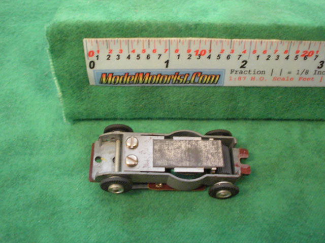 Top view of Aurora Model Motoring Vibrator Slot Car Chassis